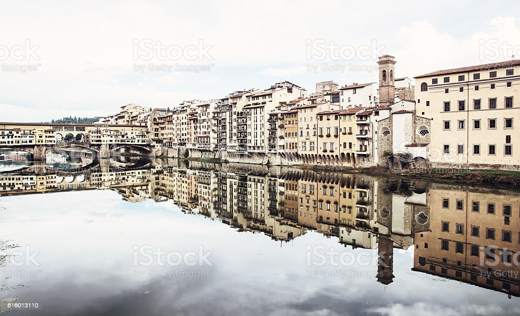 Ponte Vecchio and historical buildings are mirroring stock photo