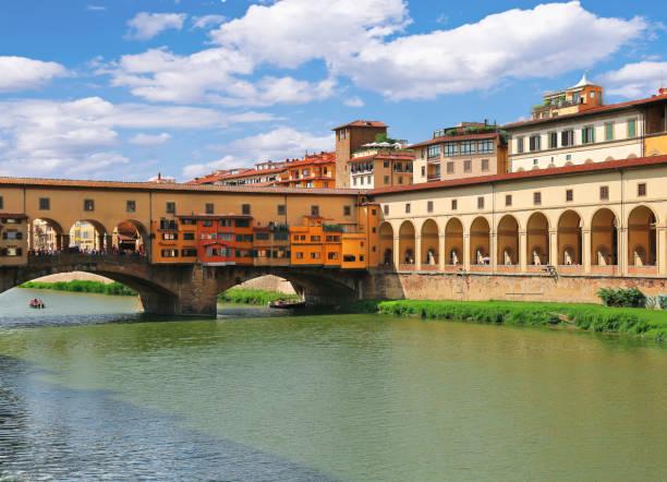Ponte Vecchio bridge and arches of Corridoio Vasariano (Vasari Corridor) across Arno river in Florence (Firenze), Tuscany, Italy stock photo