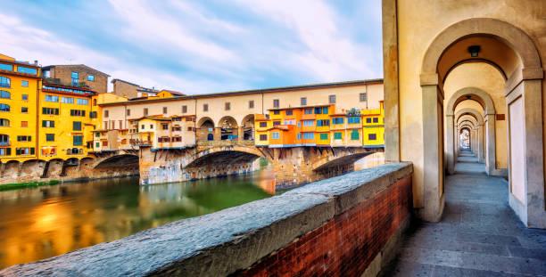 Ponte Vecchio bridge and riverside promenade in Florence, Italy stock photo