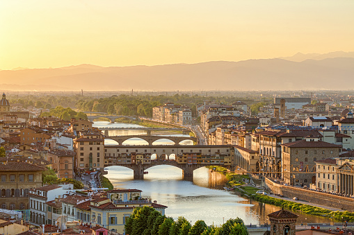 Ponte Vecchio Bridge and the Arno River in Florence at dusk