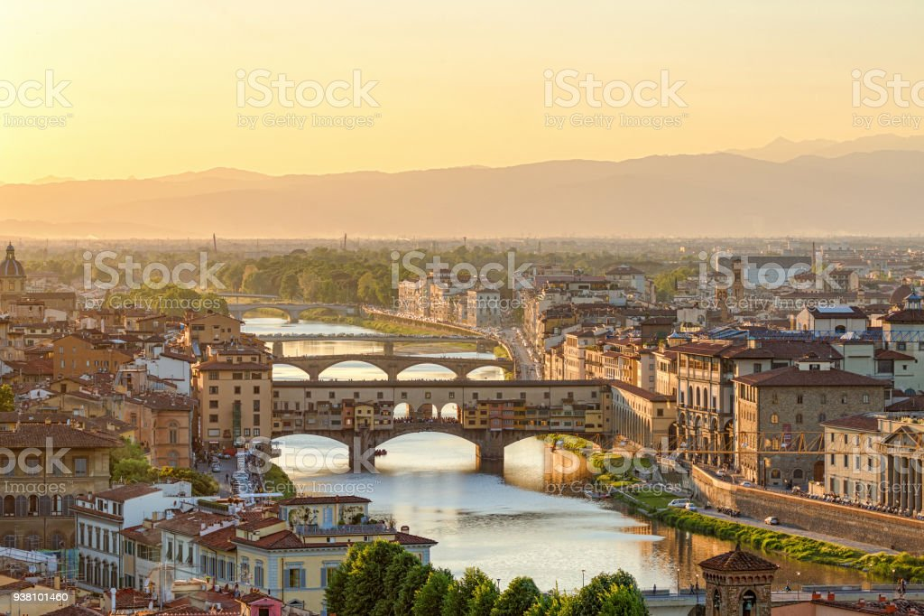 Ponte Vecchio Bridge and the Arno River in Florence at dusk stock photo