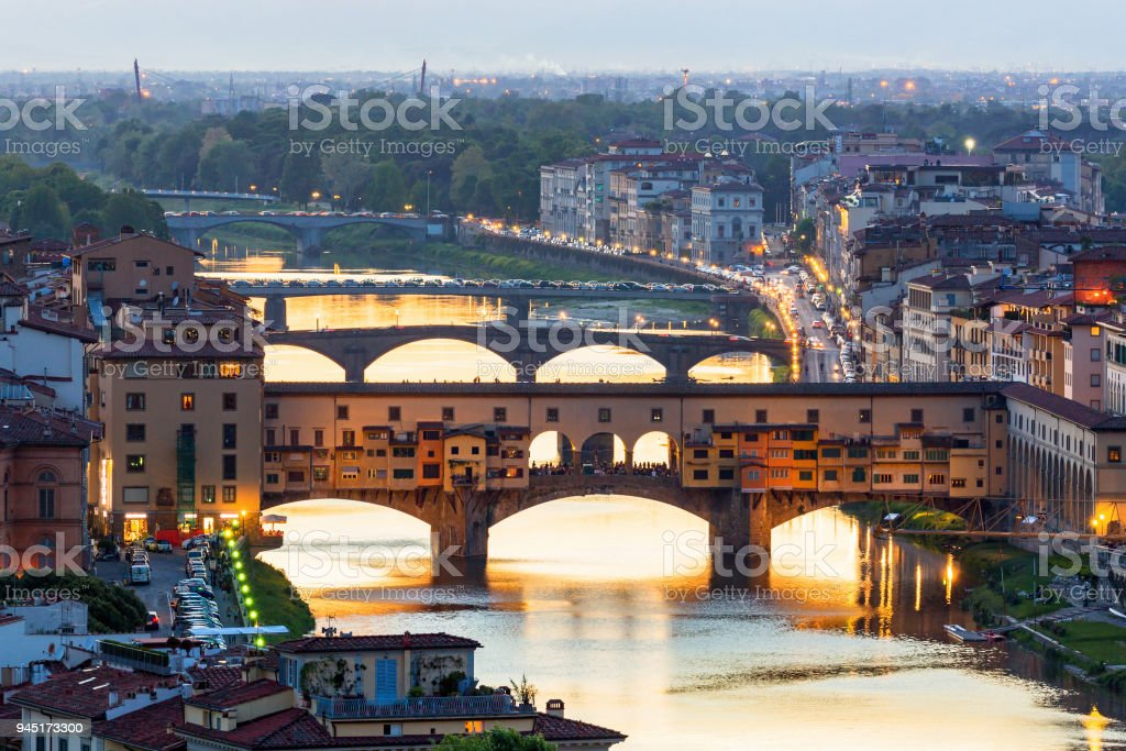 Ponte Vecchio bridge over the Arno River in Florence with floodlight stock photo
