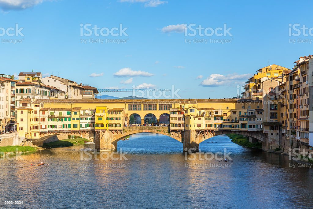Ponte Vecchio bridge with canoes on the River Arno in royalty-free stock photo