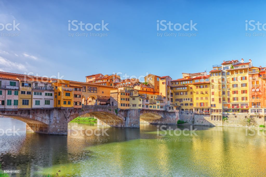 Ponte Vecchio is a bridge in Florence, located at the narrowest point of the Arno River, almost opposite the Uffizi Gallery. stock photo