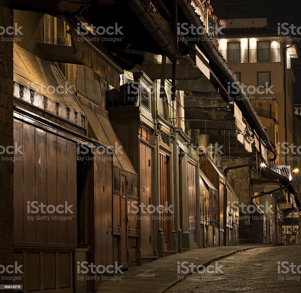 Ponte Vecchio jewelry shops at night in Florence royalty-free stock photo