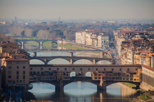 ponte vecchio on the florence city skyline italy - batalina italy стоковые фото и изображения