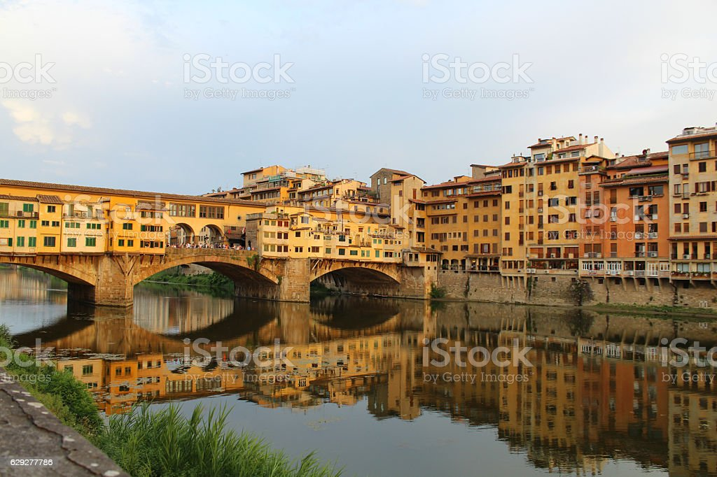 Ponte Vecchio reflected in the river stock photo