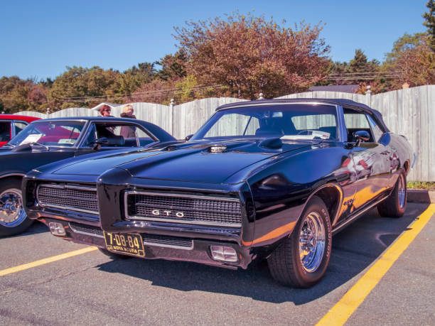 1969 Pontiac GTO convertible muscle car Bedford, Nova Scotia, Canada - September 16, 2012 : 1969 Pontiac GTO convertible at Annual Memory Lane Show & Shine, Bedford Place Mall. 1960 1969 stock pictures, royalty-free photos & images
