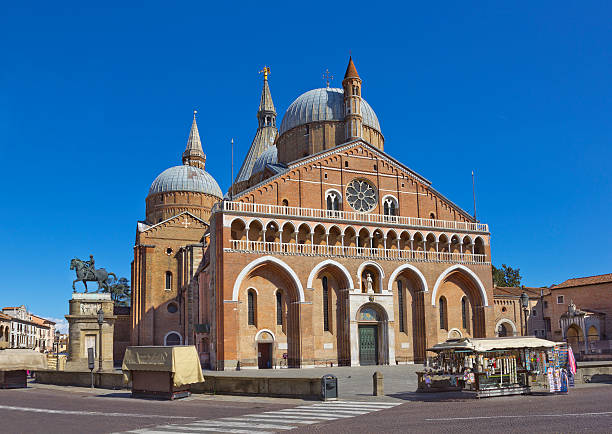 Pontifical Basilica of Saint Anthony of Padua, Italy Pontifical Basilica of Saint Anthony of Padua  (Il Santo) in Padua, Italy with Donatello's equestrian statue of Gattamelata made in 1453 on the left st. anthony of padua stock pictures, royalty-free photos & images