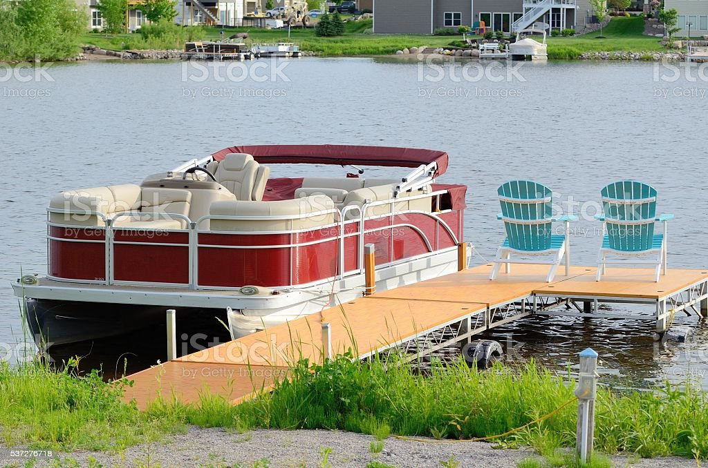 Pontoon Boat Tied to a Dock stock photo