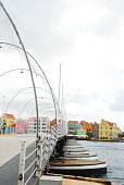 The iconic pontoon bridge in downtown Willemstad, Curacao against the colorful architecture