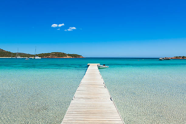 Pontoon  in the turquoise water of  Rondinara beach in Corsica stock photo