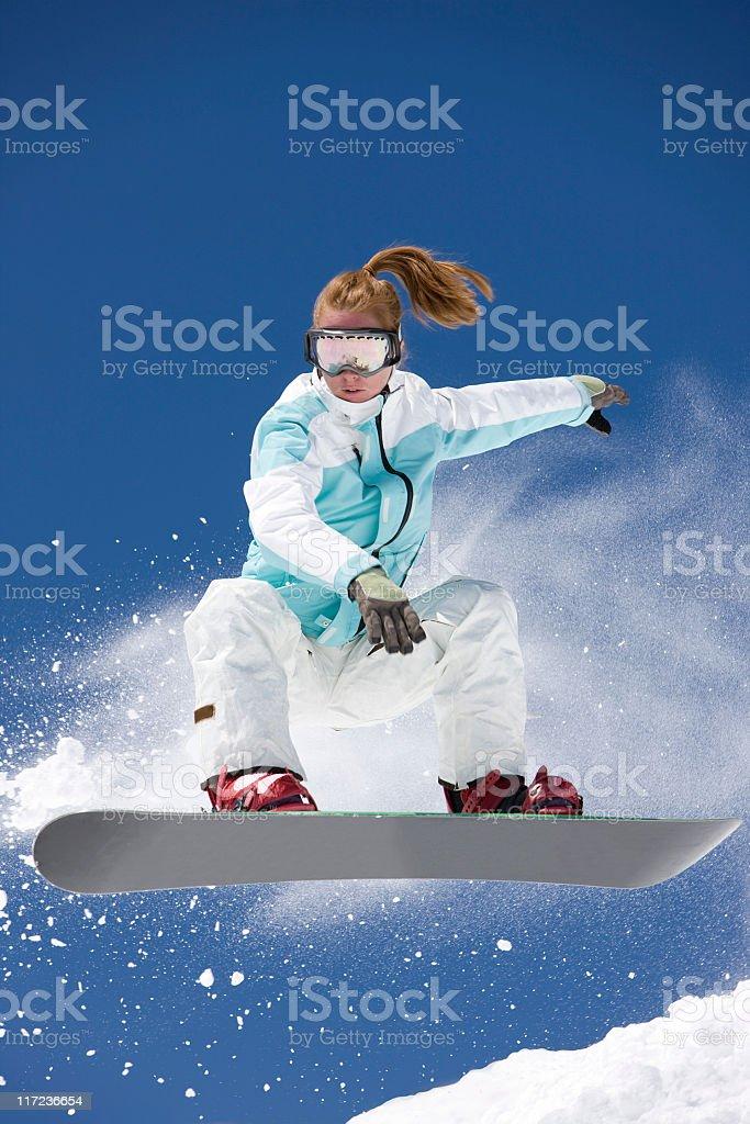 Ponytailed Snowboarder royalty-free stock photo
