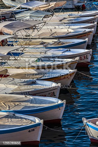 Ponza, Latina, Lazio, Italy - 2 July 2020: Row boats moored, ready for excursions by tourists around the island,