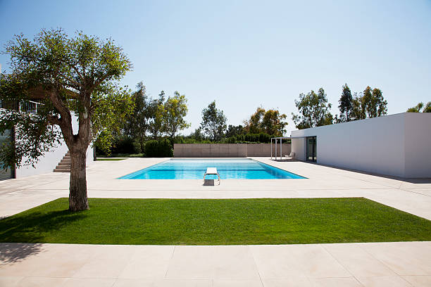 Pool and courtyard outside modern house stock photo
