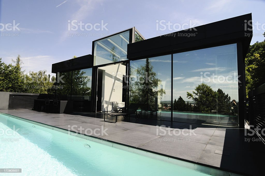 pool and modern granite home royalty-free stock photo