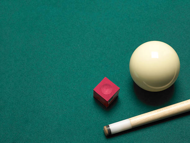 Pool ball, chalk and cue stock photo