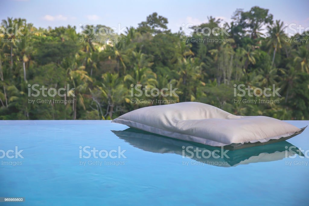 Pool bean bag floating in luxury hotel pool - Royalty-free Bali Stock Photo