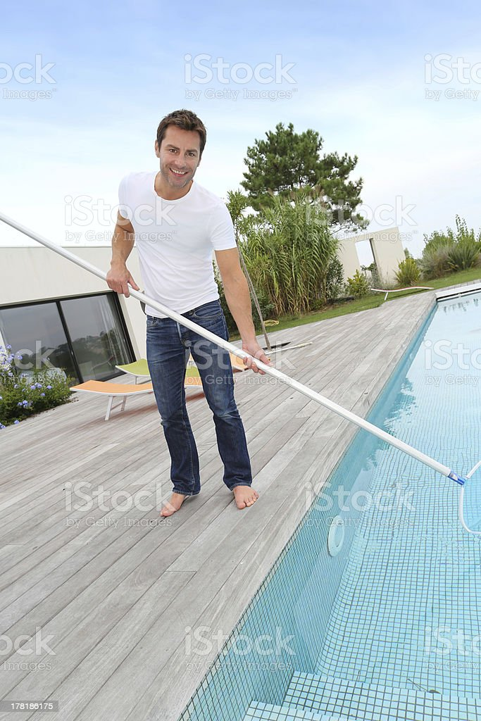 Pool cleaner in modern house royalty-free stock photo