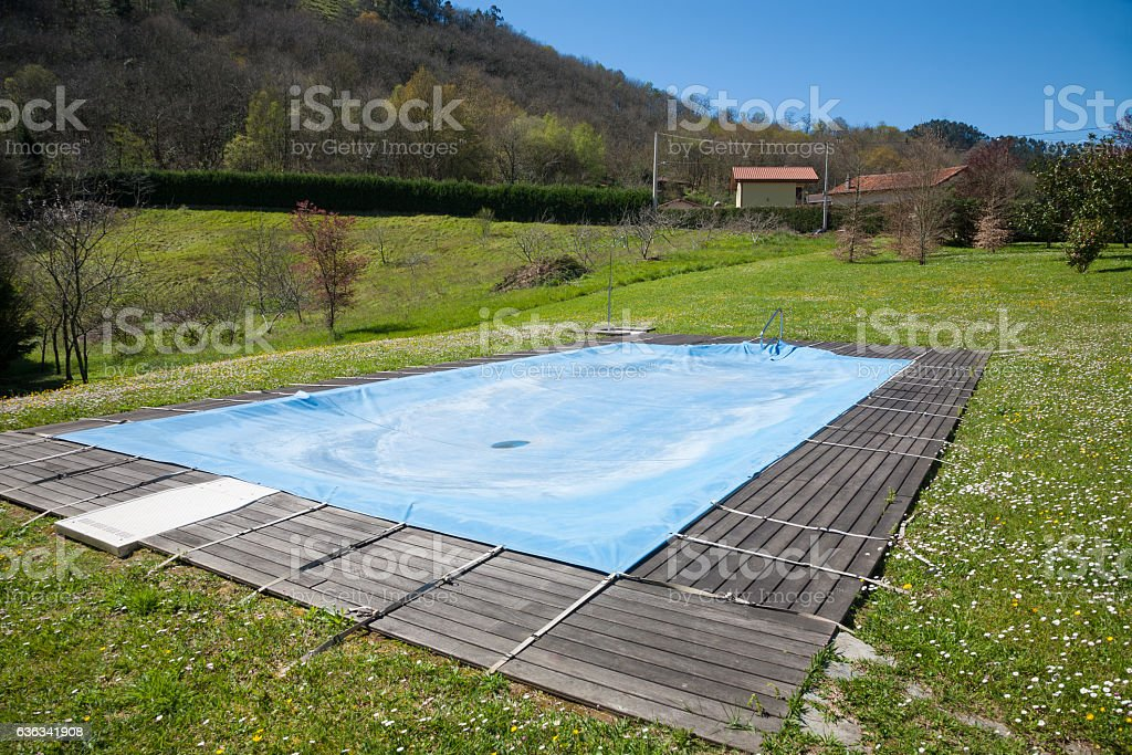 pool closed in green meadow stock photo