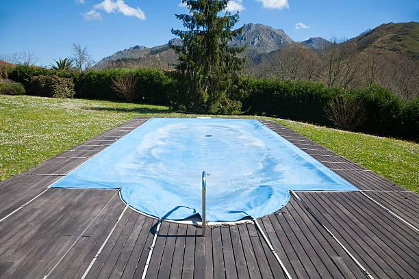 pool closed with blue tarp stock photo