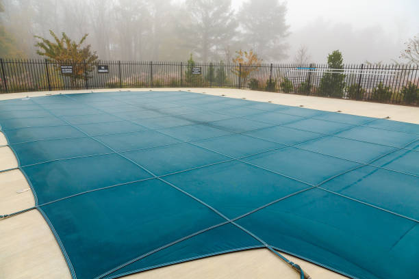 Pool Cover in Fog A Blue Vinyl Pool Cover in Fog covering stock pictures, royalty-free photos & images