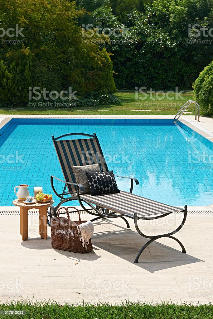 pool deck chairs and decoration stock photo