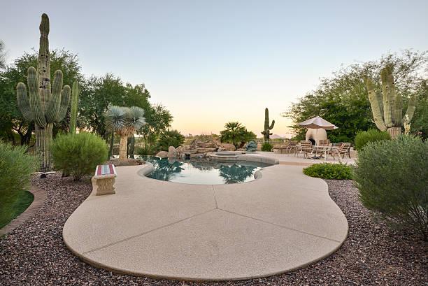 A pool in a desert home backyard stock photo