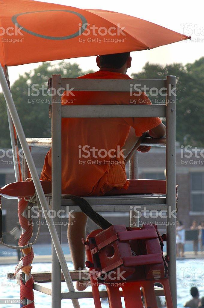 Pool Lifeguard w Orange Umbrella stock photo