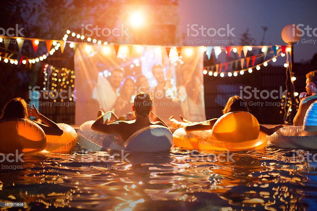 Pool movie night party. stock photo