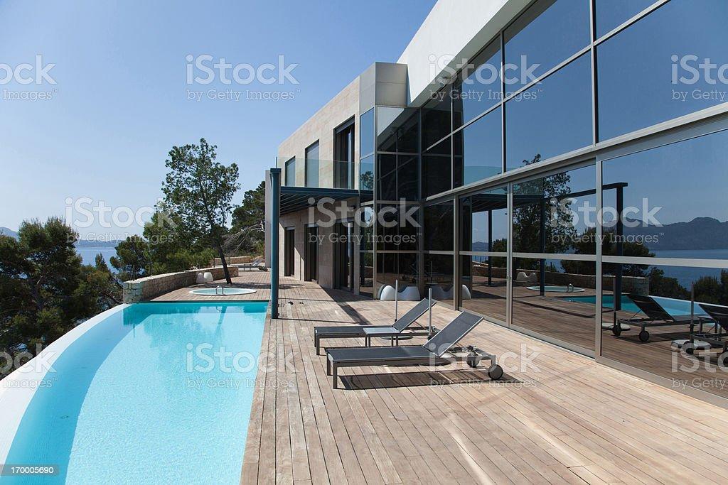 Pool outside modern house royalty-free stock photo