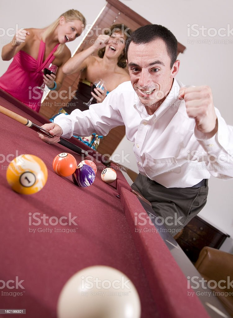 Pool Player Successfully Hitting the Ball In royalty-free stock photo