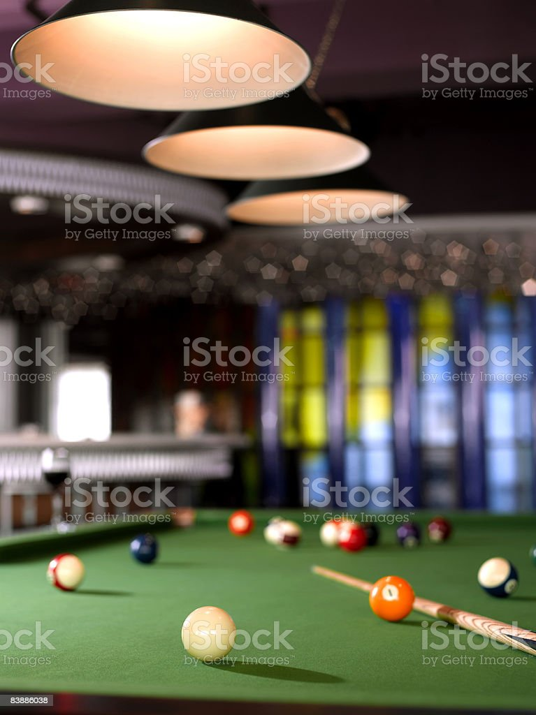 Pool table and glass of wine. royaltyfri bildbanksbilder