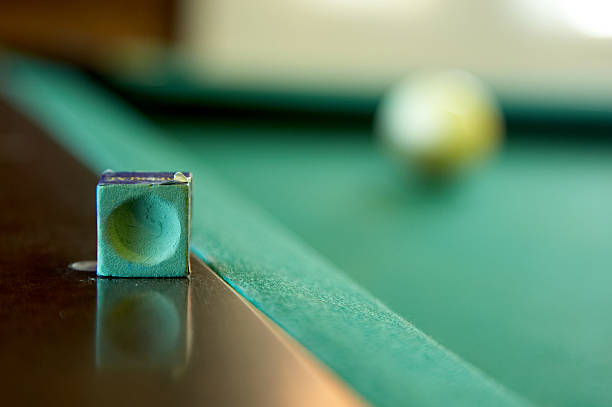 Pool table chalk and ball stock photo
