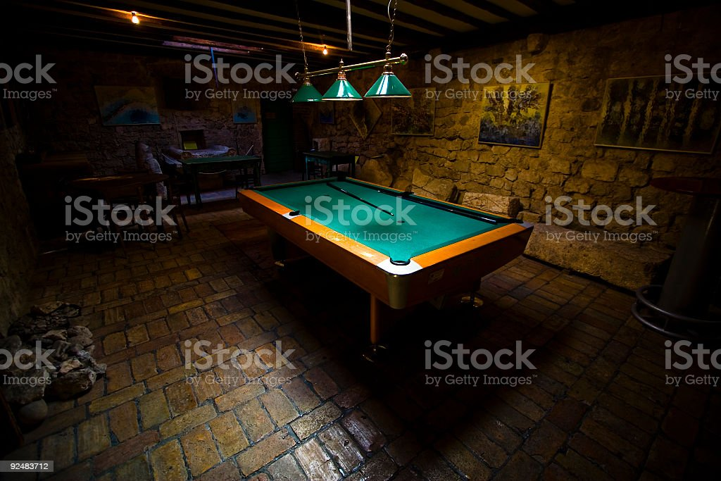 Pool Table in a Dark Basement royalty-free stock photo