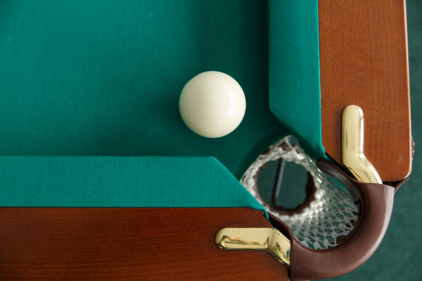a pool table. top view. the ball rolls into the pocket. - cue ball stock pictures, royalty-free photos & images