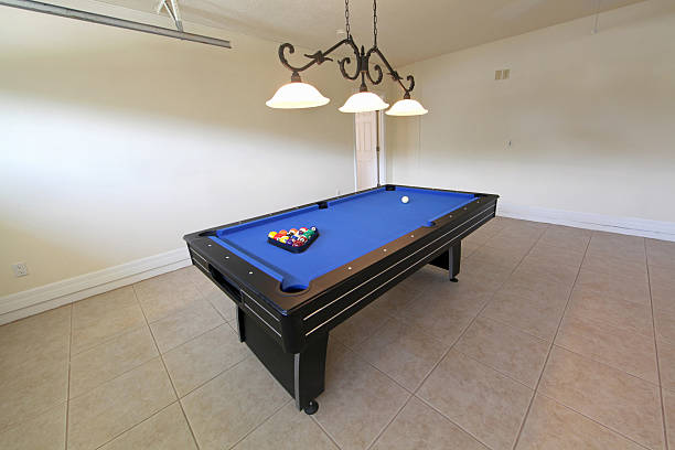 Pool table with blue tread for playing A pool table in a garage in Florida man cave stock pictures, royalty-free photos & images