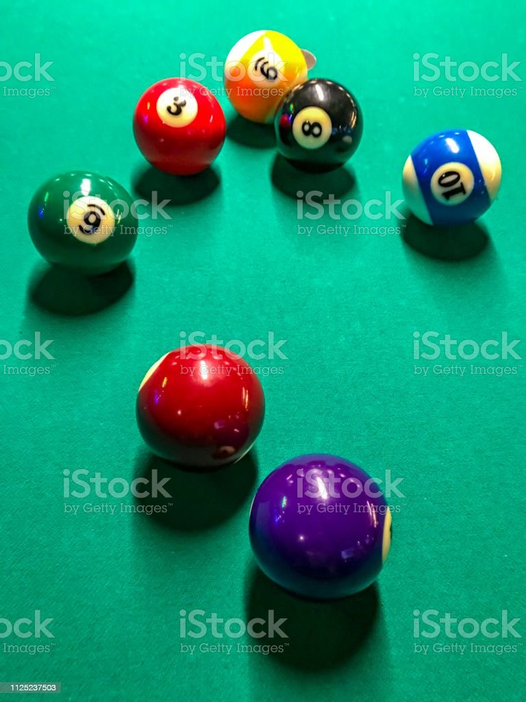 The vibrant colors are on display during a friendly game of pool.