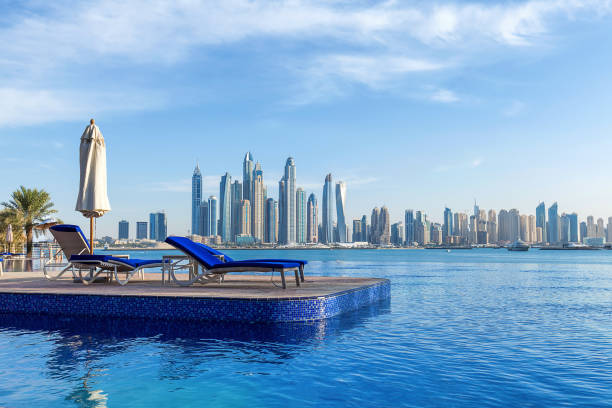 Pool view to Dubai Marina Pool view to Dubai Marina dubai stock pictures, royalty-free photos & images