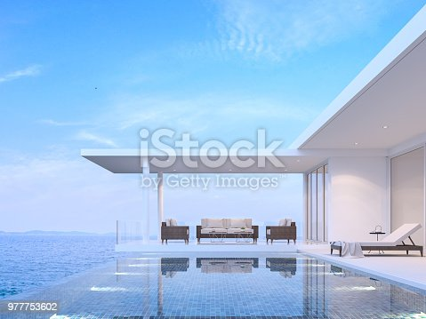 1066863894 istock photo Pool villa living room with sea view 3d render 977753602