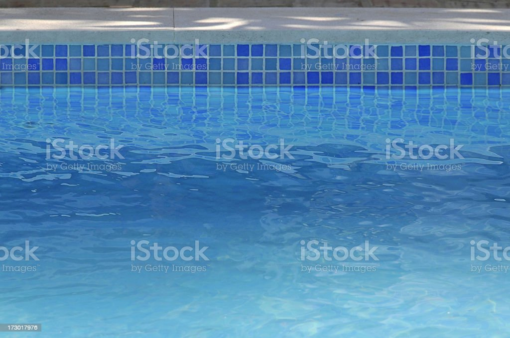 Pool with different colored blue tiles royalty-free stock photo