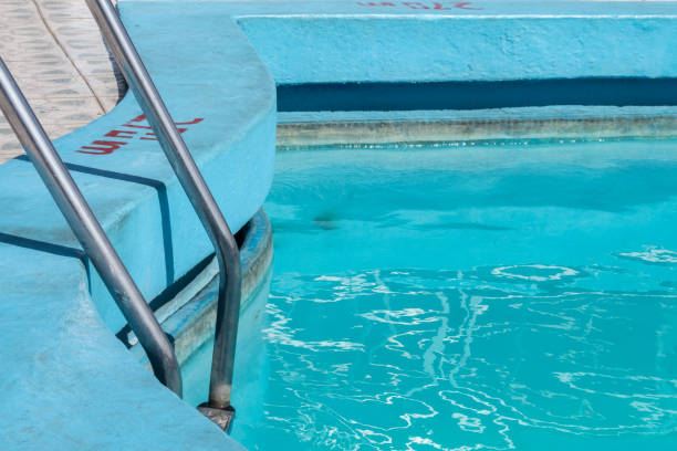 Pool with ladder and blue paint, Havana stock photo