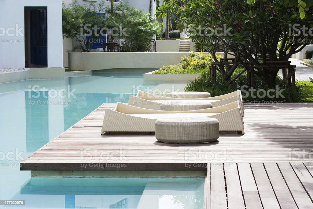 pool wooden bed stock photo