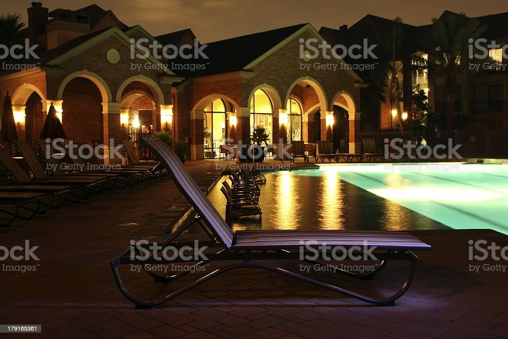 Poolside at night royalty-free stock photo