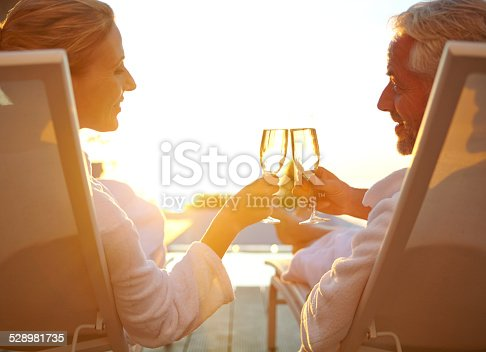istock Poolside bubbly and relaxation 528981735