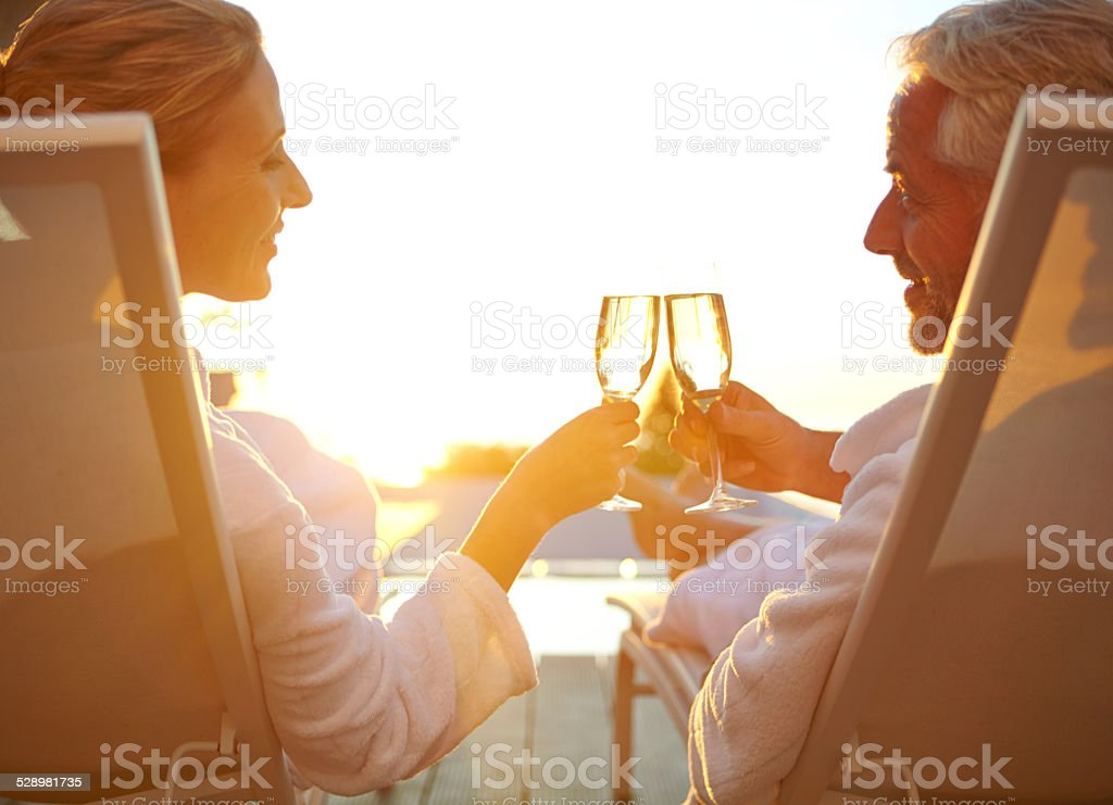 Poolside bubbly and relaxation stock photo