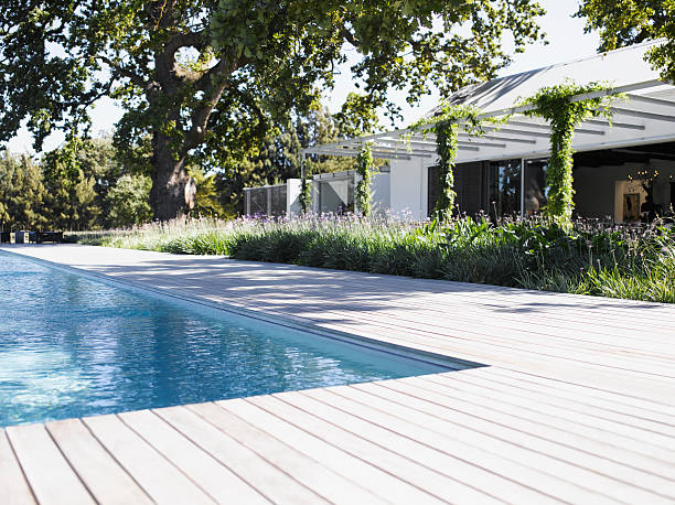 Poolside by swimming pool of modern home stock photo