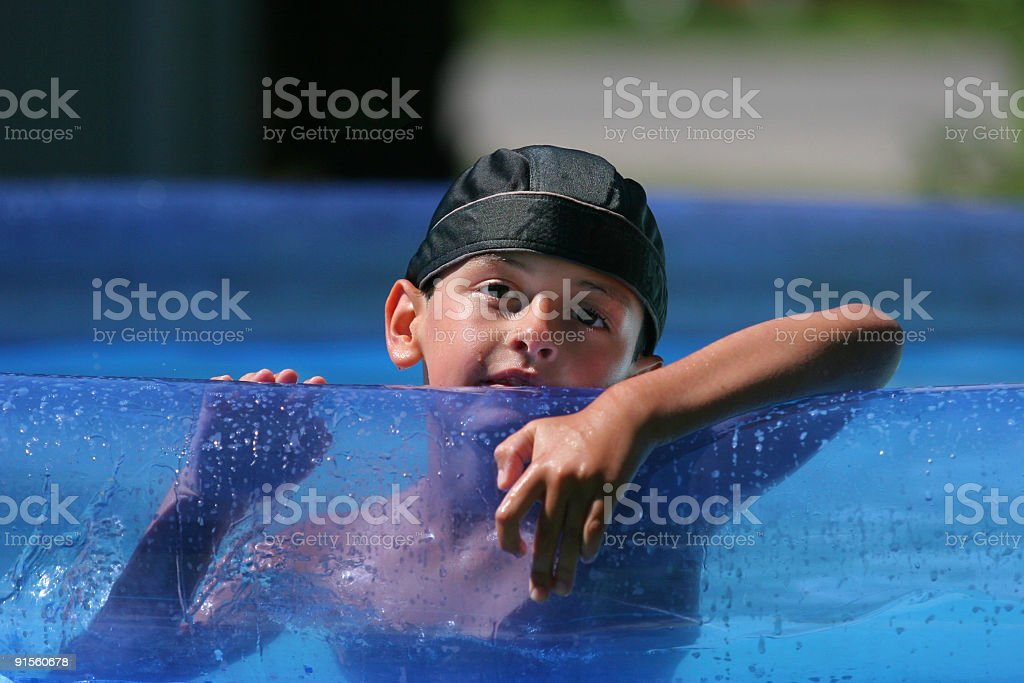 Poolside Kid stock photo