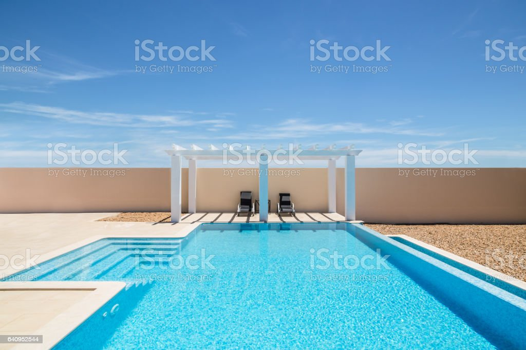 Poolside Pergola And Infinity Swimming Pool Stock Photo - Download Image Now