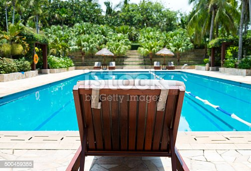 Swimming pool with chaise longue